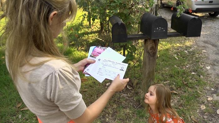 mom reading post card notice